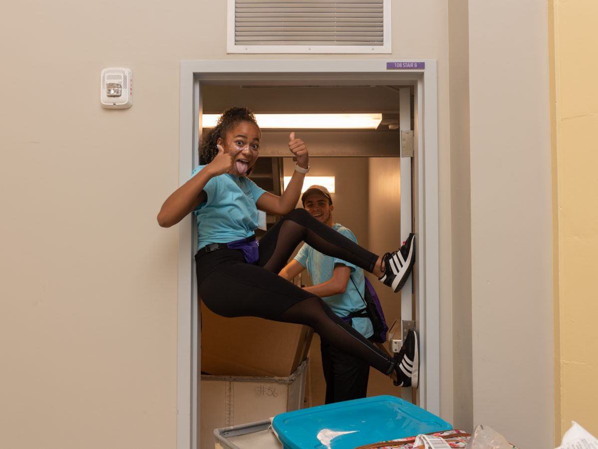 A student props herself up in a doorway
