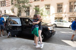 First-year roommates are excited to see each other during move-in day at the Little Building. (Photo taken by Derek Palmer for Emerson College)