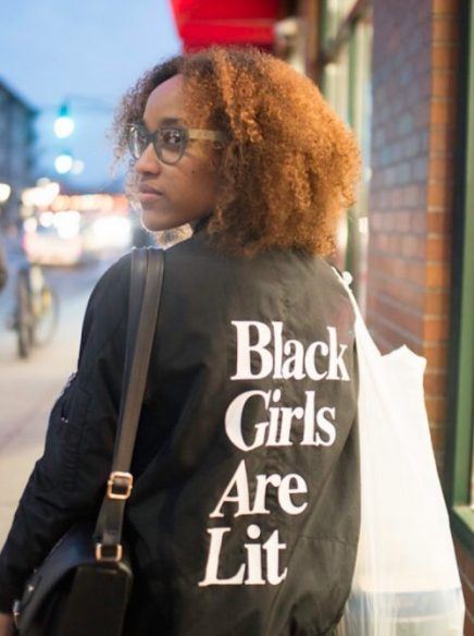Ciera Burch wearing a jacket that says Black Girls Are Lit