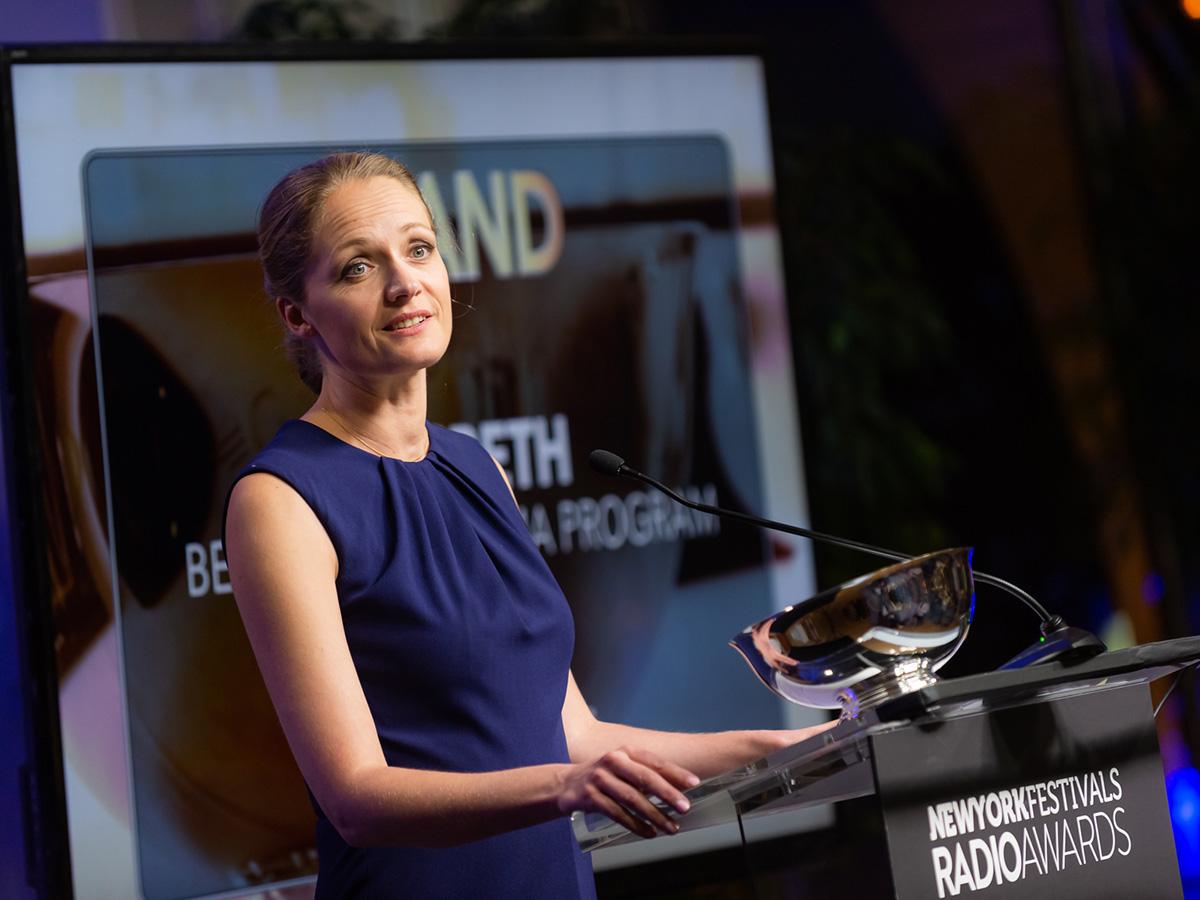 Charlotte Melen speaking at podium