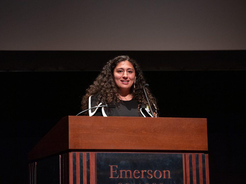 Raz Moayed at a podium