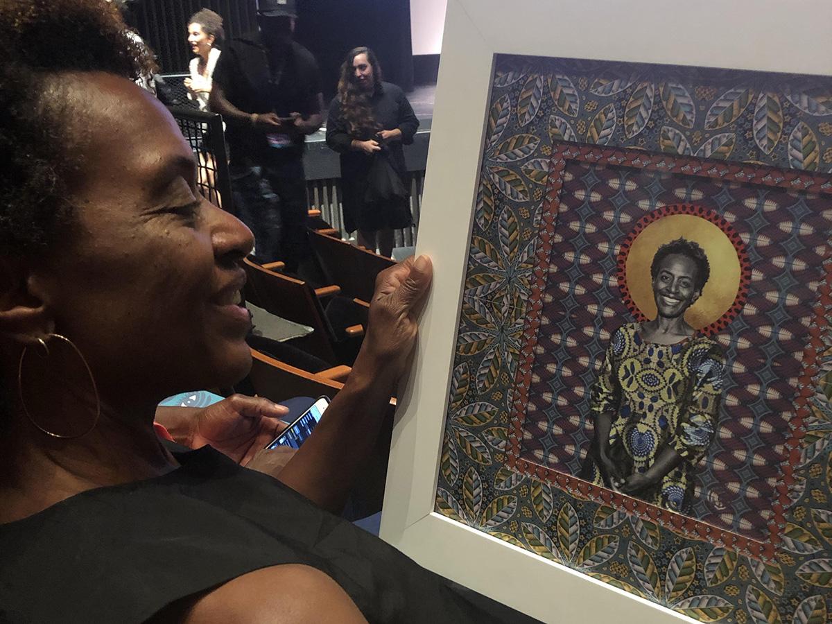 Marcia Smith holding award