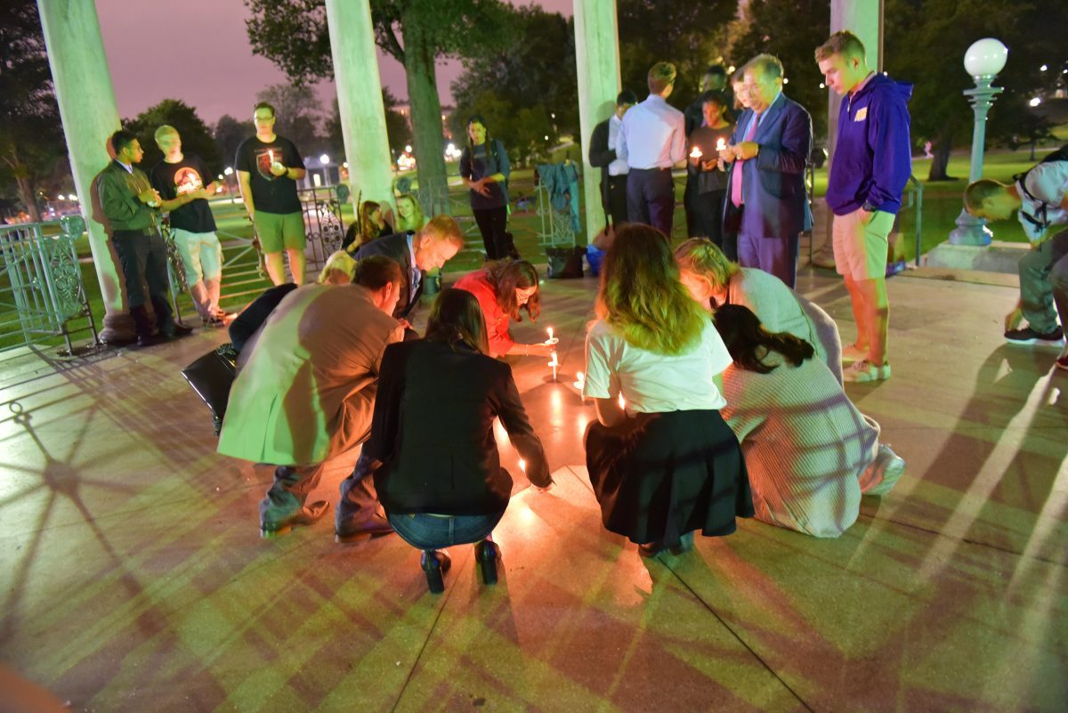 Students light candles at 9/11 vigil
