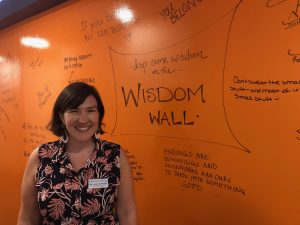 Director of Religious and Spiritual Life & Campus Chaplain, Julie Avis Rogers, by the wisdom wall in the Center for Spiritual Life.
