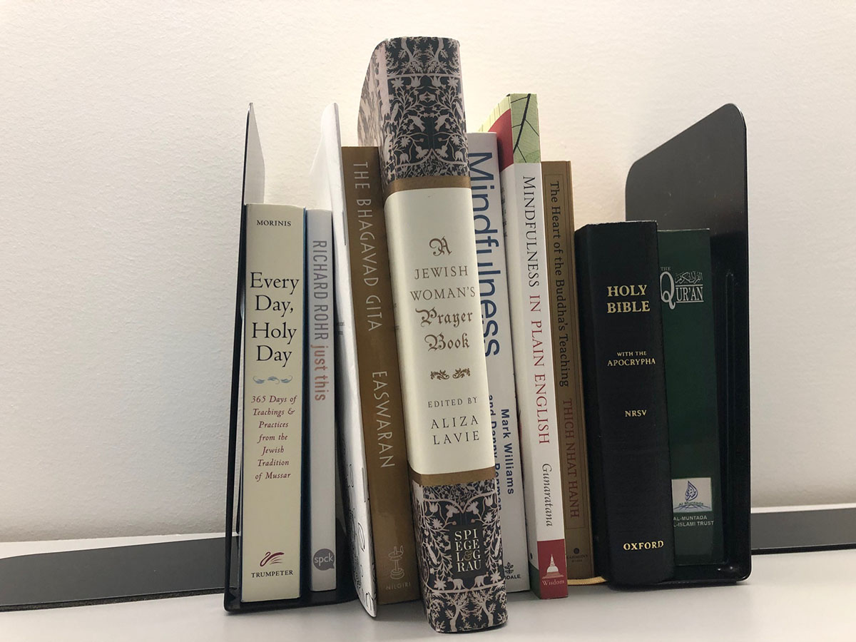 Books from numerous faiths located at Emerson College's Center for Spiritual Life.