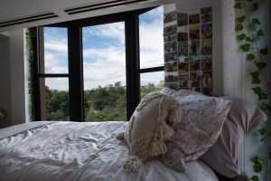 A bedroom overlooks the Boston Common