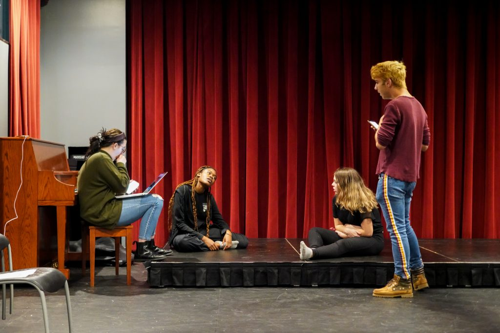 Students rehearse on stage