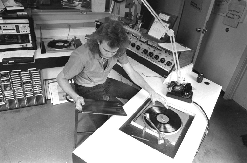 DJ spins vinyl on a turntable at WERS studios in April 1986.