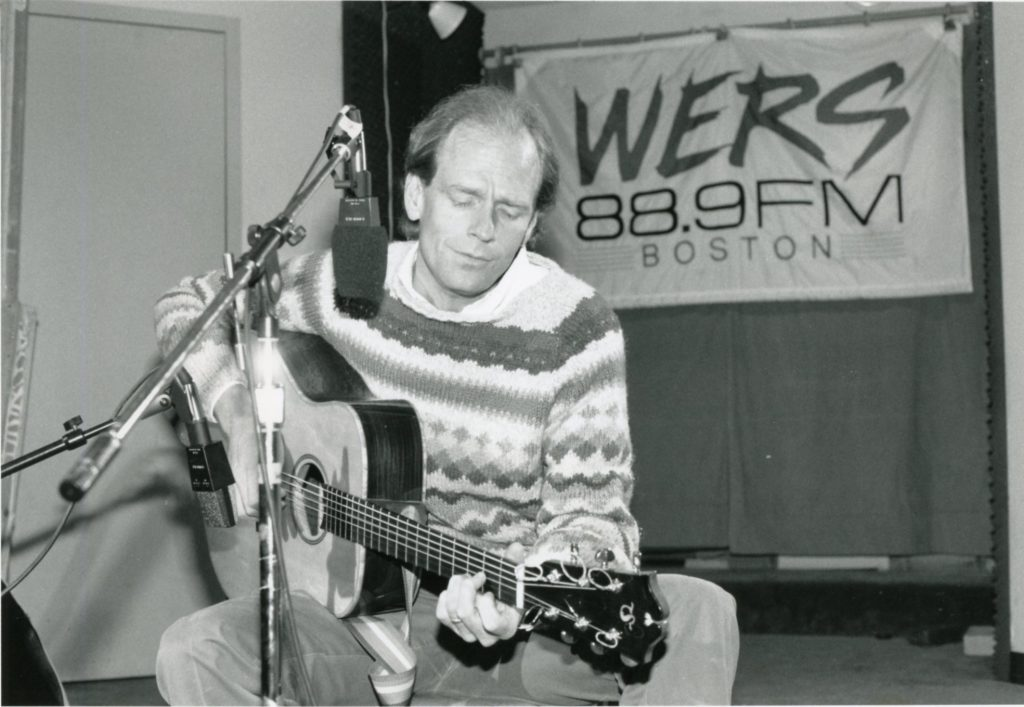 Livingston Taylor plays guitar