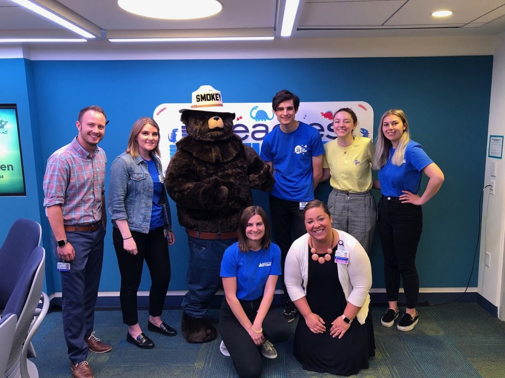 Fendt, coworkers, Smokey the Bear
