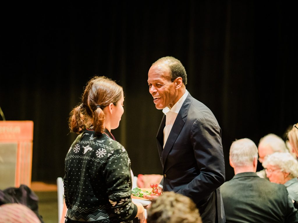 Emerson College President Lee Pelton speaks with a student.