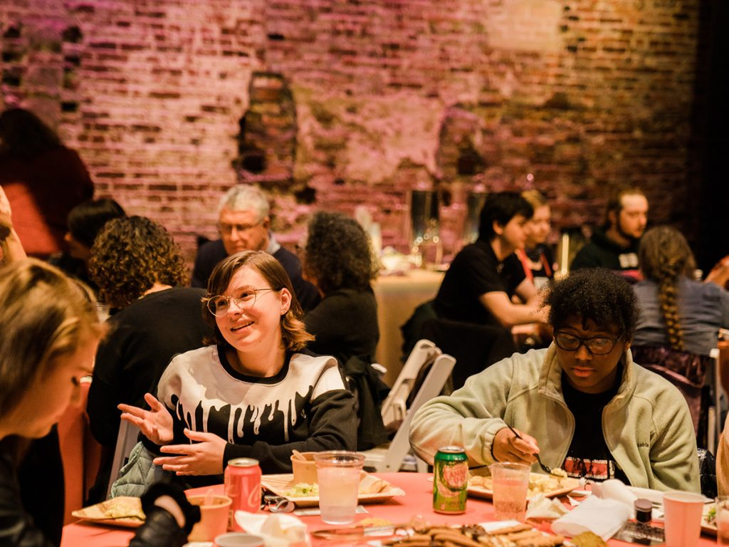 Students eat at the reception.