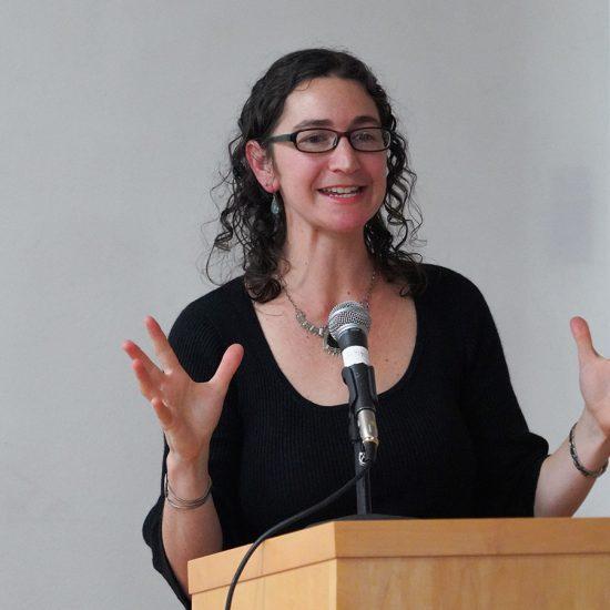 mneesha gellman at podium