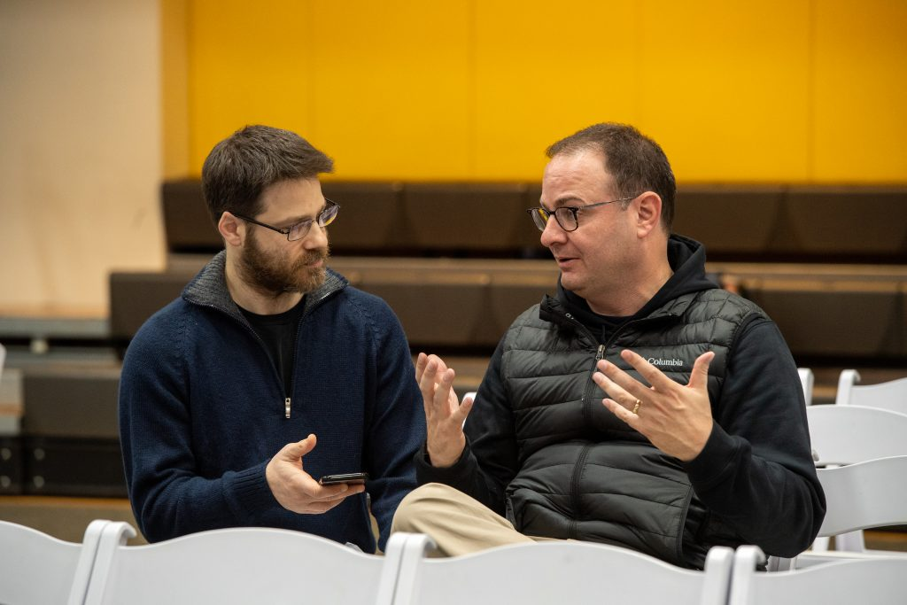 Adrian Wojnarowski speaks with Emerson Today's David Ertischek before the live taping of the Woj Podcast on Dec. 5, 2019. (Photo by Derek Palmer for Emerson College)