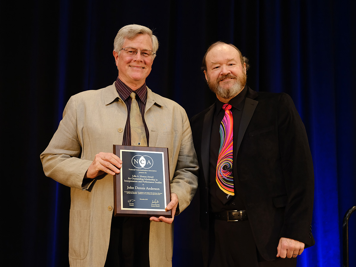 Anderson holds award with NCA president