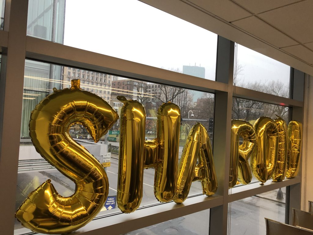 Balloons spell out the word Sharon.