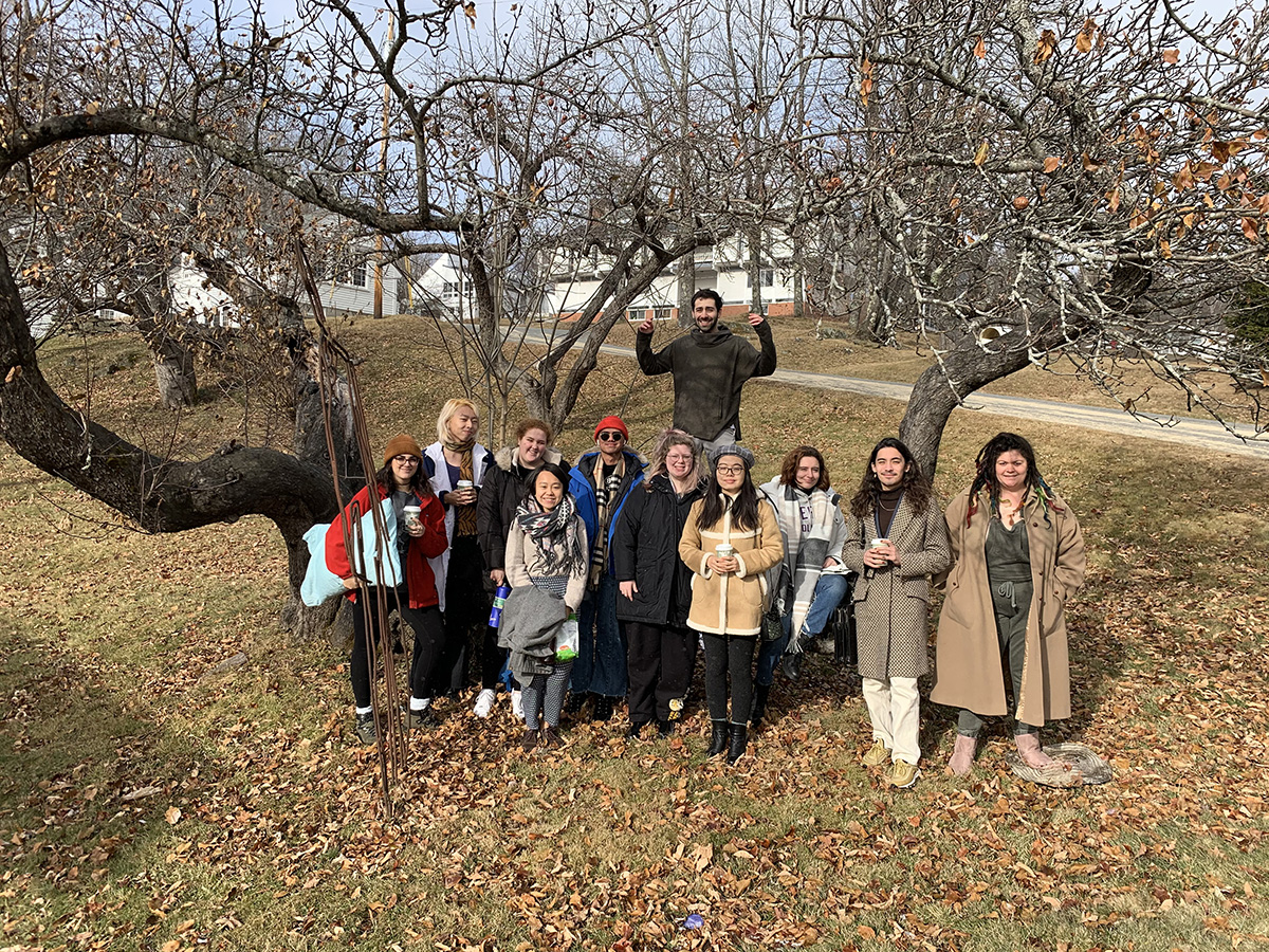 students standing in front of tree