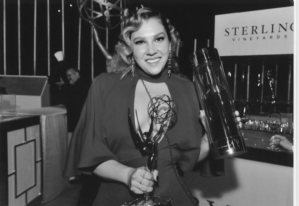 Brittany Martin Porter holds an Emmy Award