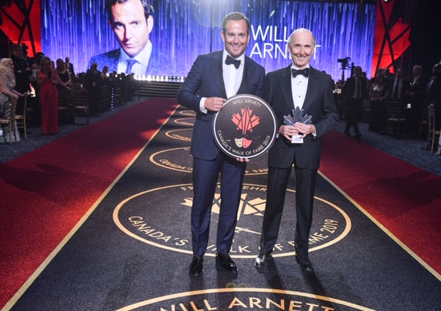 Will Arnett and Emerson James Arnett stand at a ceremony for Will's introduction into the Canada Walk of Fame.