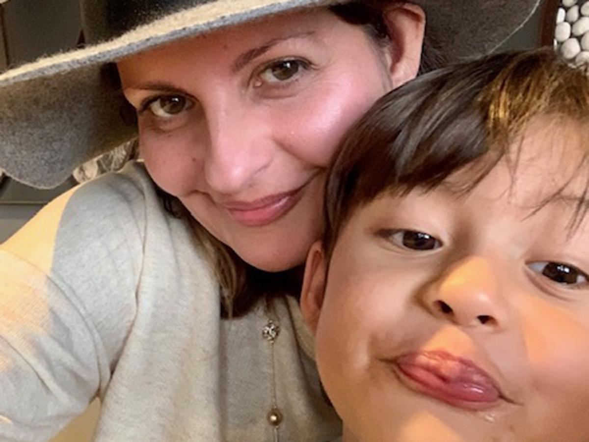 Jessica Hill Cabrera-Contaoi holding son
