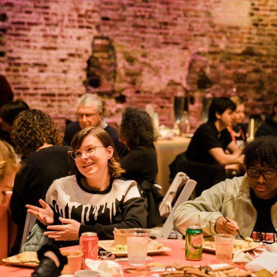 students talk at table