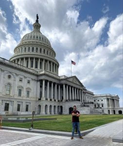 Matt Enriquez in front of Capitol