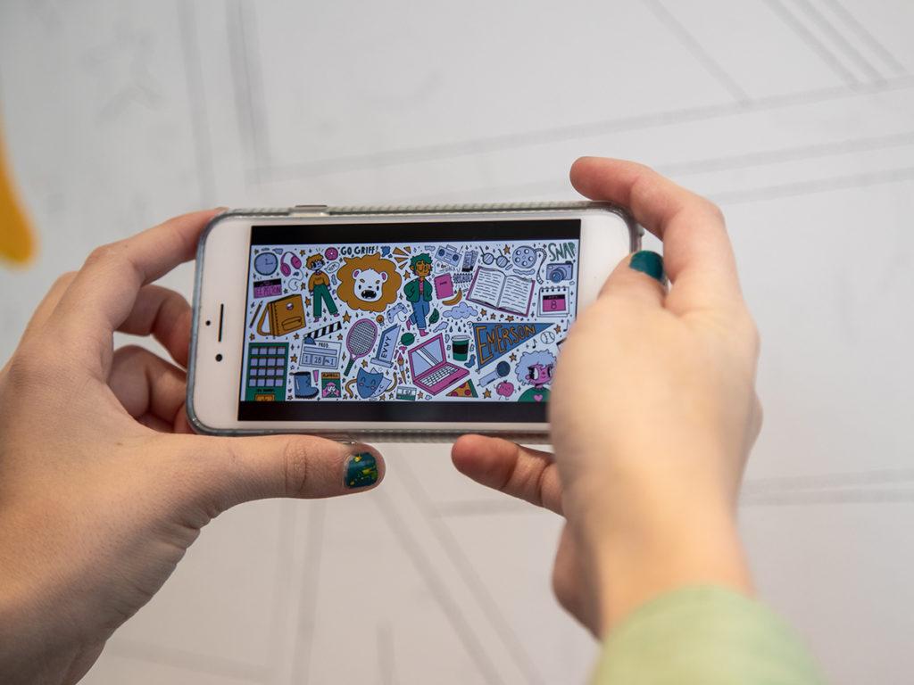 Mural through screen of phone