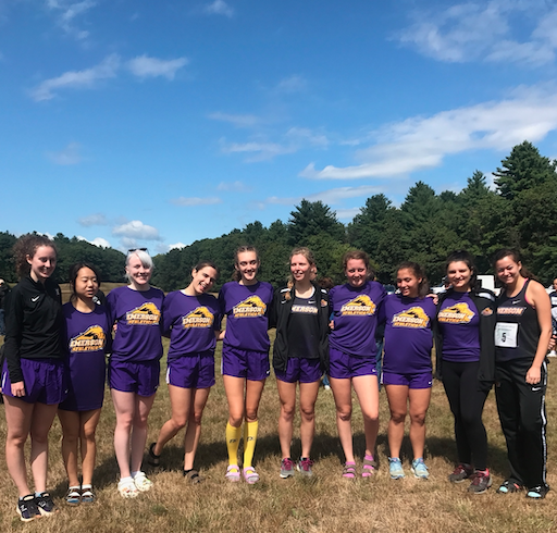 women's cross-country team stand together