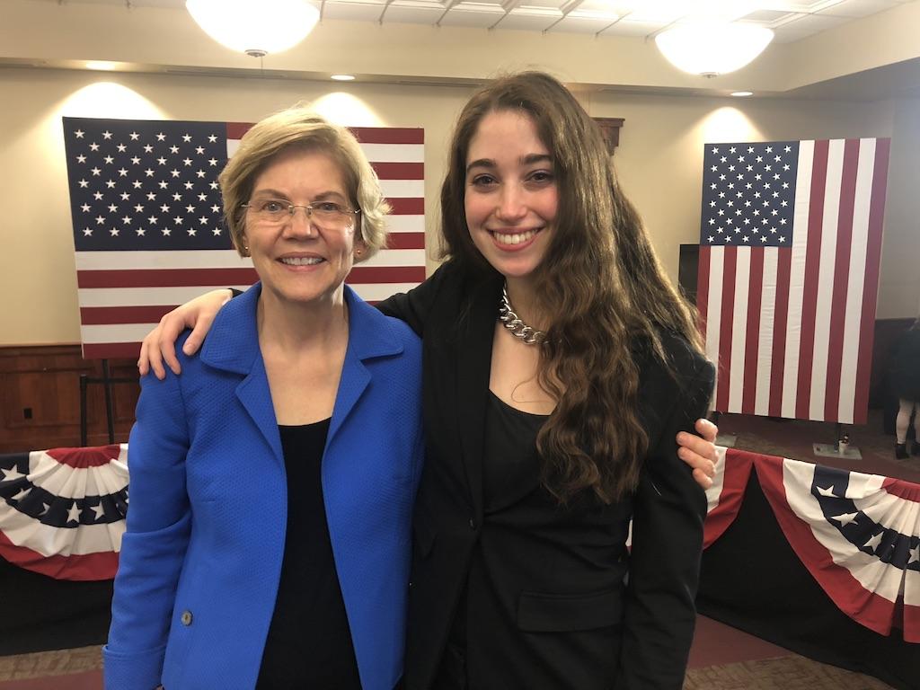 Julia Stanton stands with Elizabeth Warren