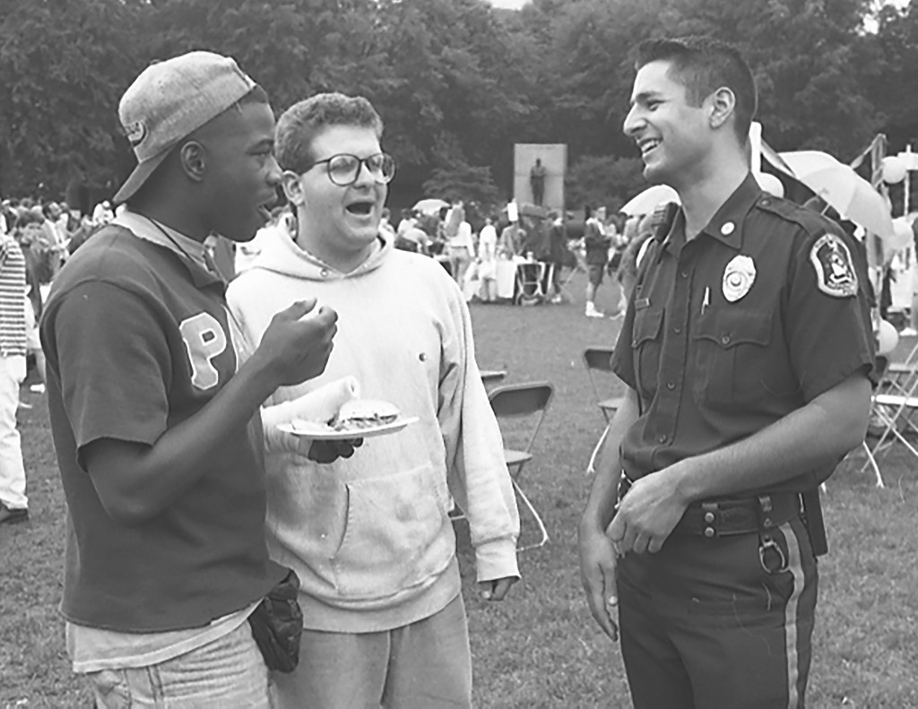 Emerson students and a public safety officer talk at the 1992 Emerson on the Hatch Shell event.