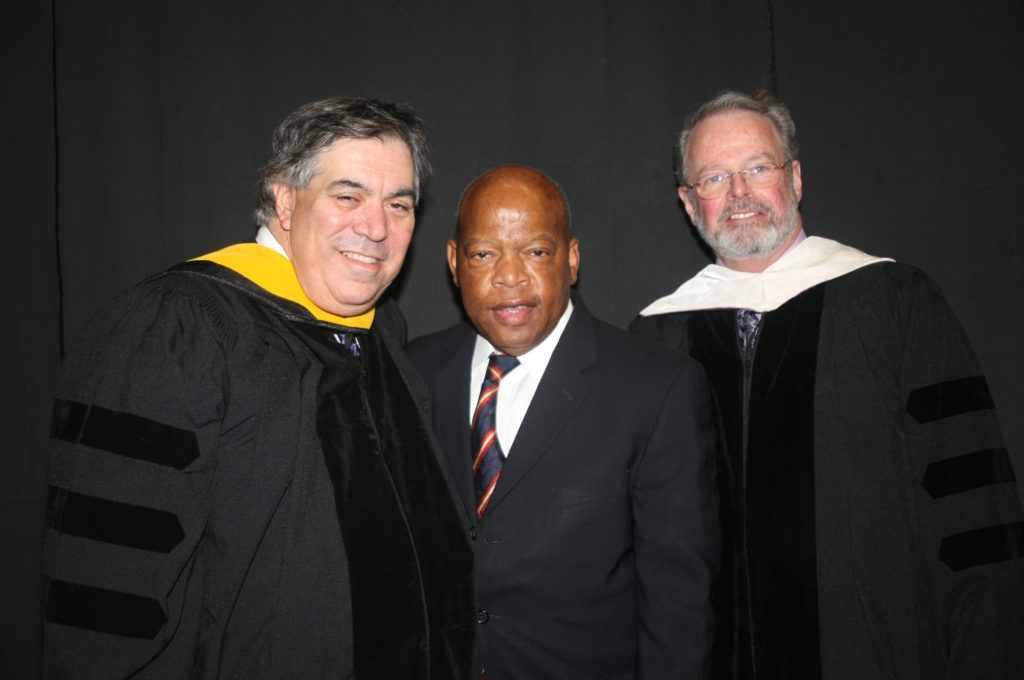 Larry Rasky, US Congressman John Lewis and Peter Meade stand together.