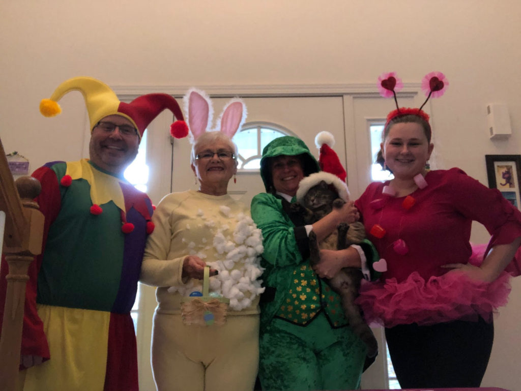 Four people dressed up in costumes
