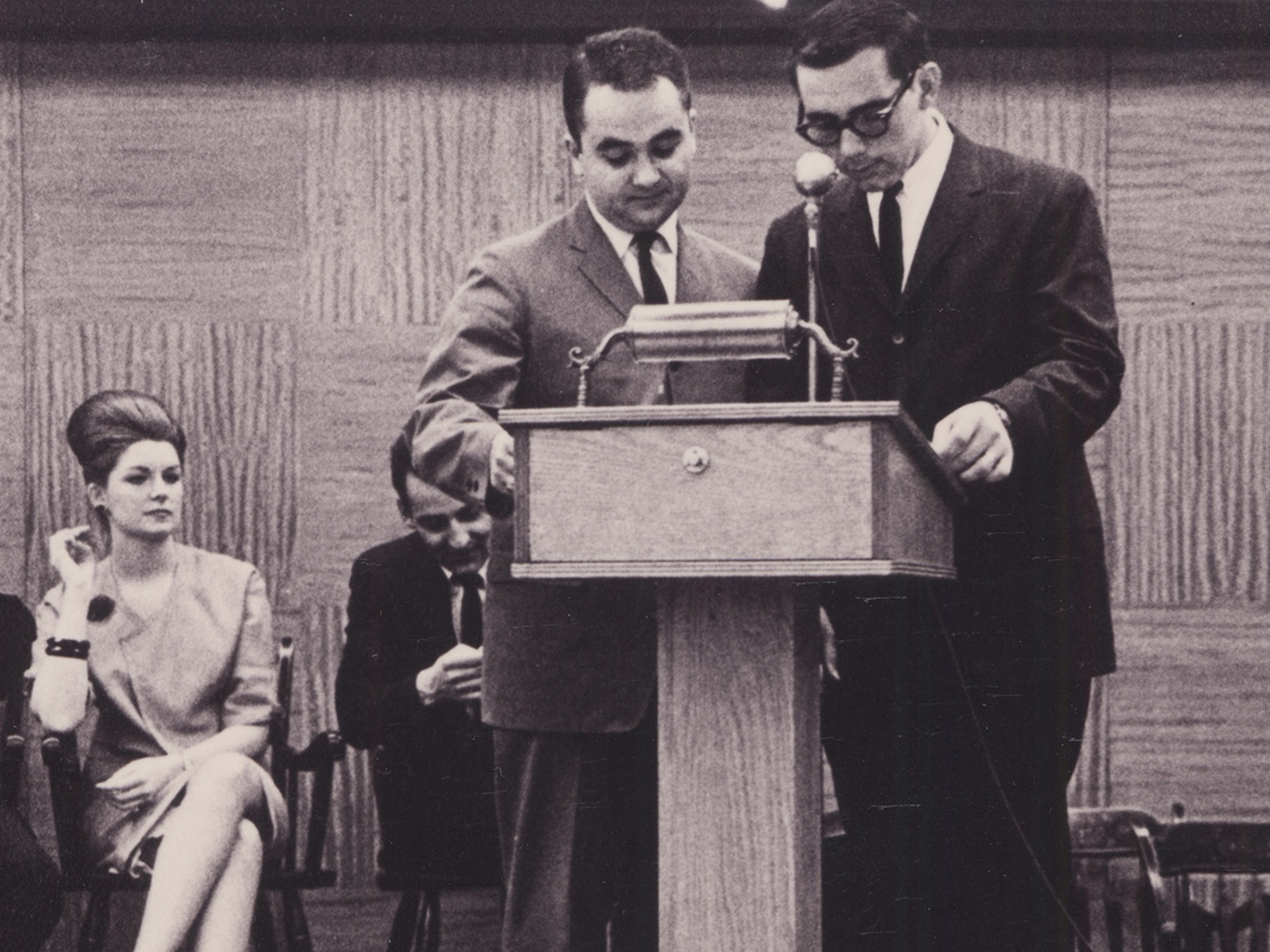 Leo Nickole and man at podium
