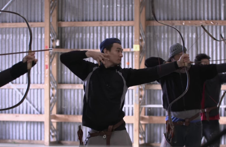 Men practice archery