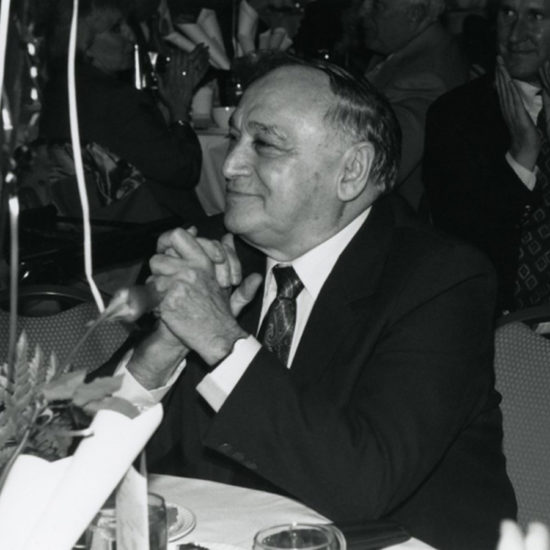 Leo Nickole at table with balloons