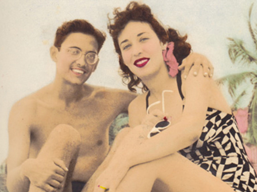 man and woman on beach, 1940s