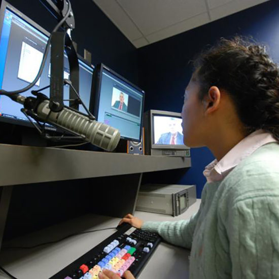 A person in a video editing suite.