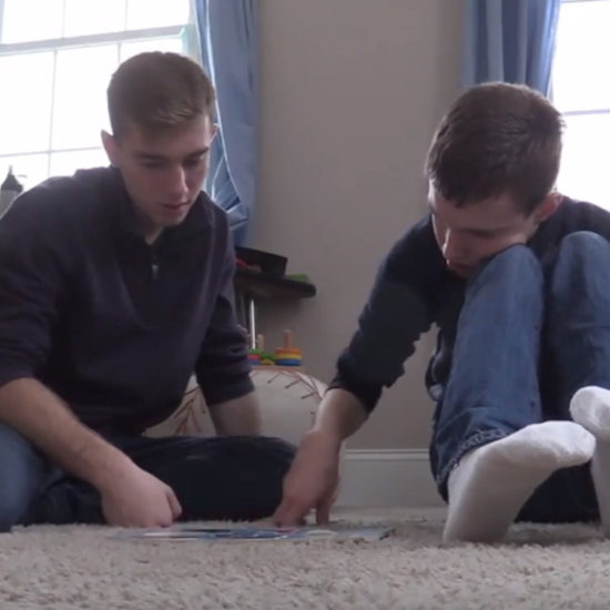 Teenaged boys sit on floor