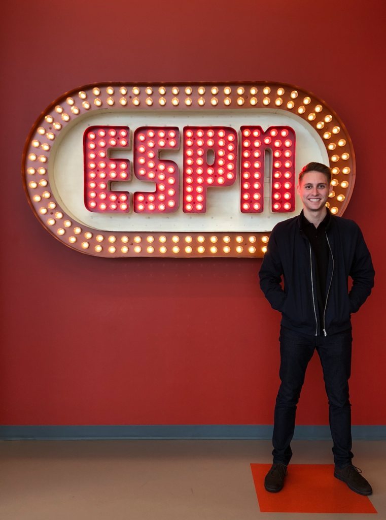 Zach Rothfeld standing in front of a sign that says ESPN