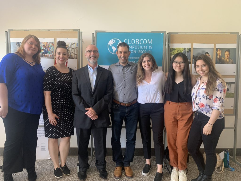 Emerson students next to Emerson School of Communication Dean Raul Reis and Professor David Richard Gerzof at GlobComm 2019 in Lisbon, Portugal. [Courtesy Photo]