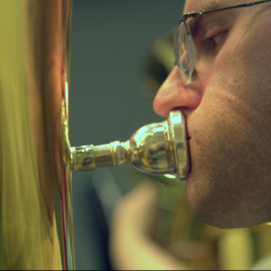 closeup of man playing tuba