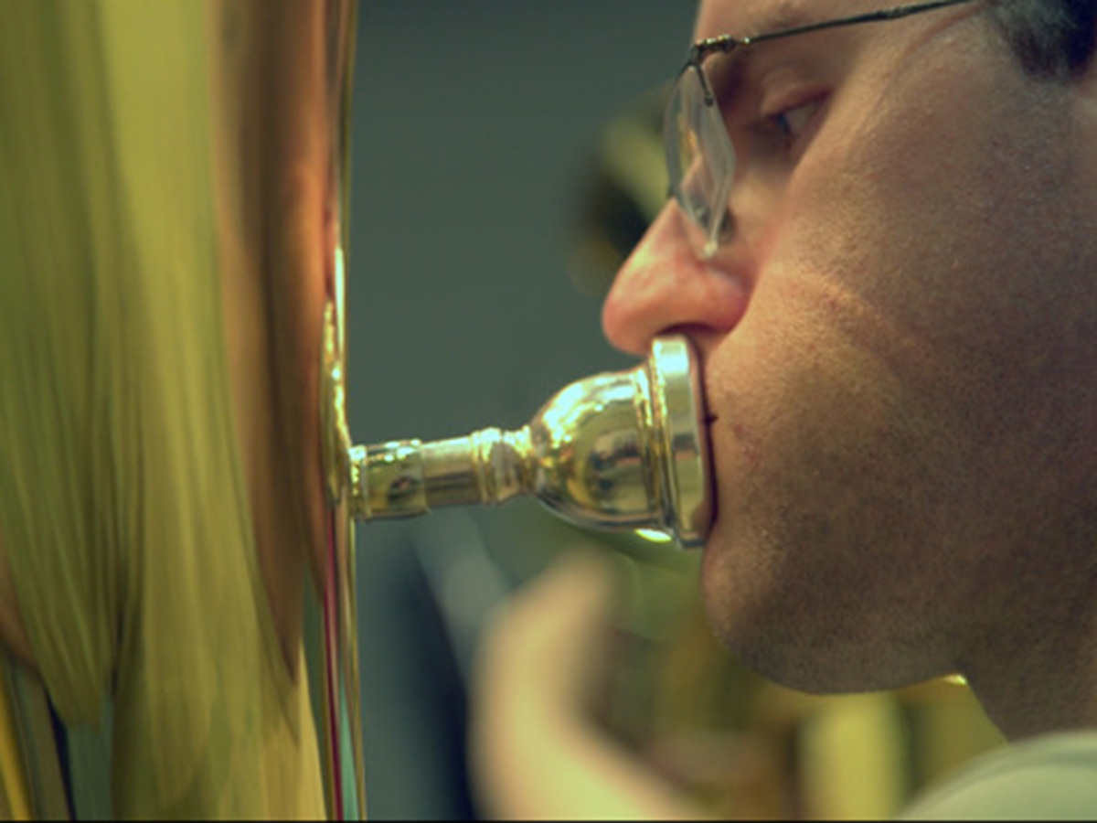 closeup of man playing tuba