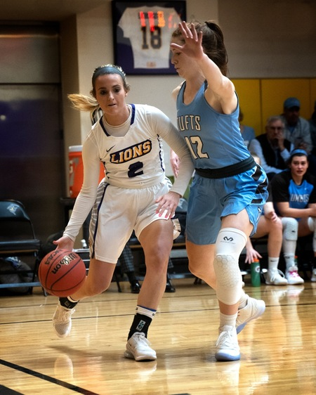 clydesdale dribbles ball away from tufts player