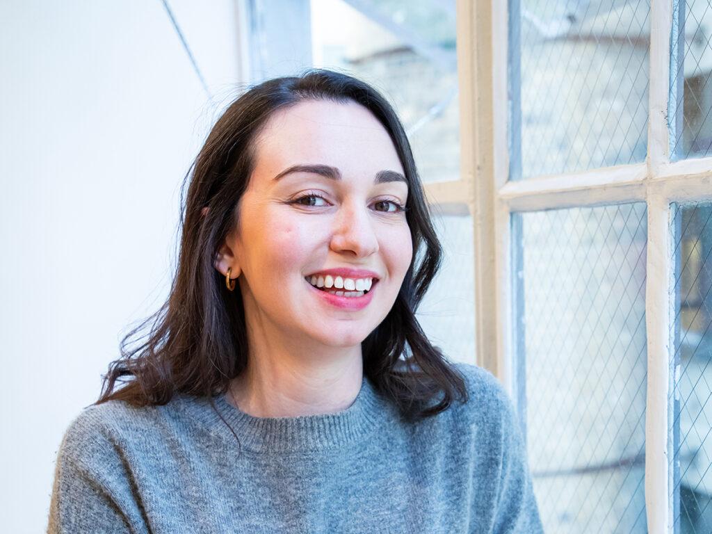 Amy Beecher in front of window