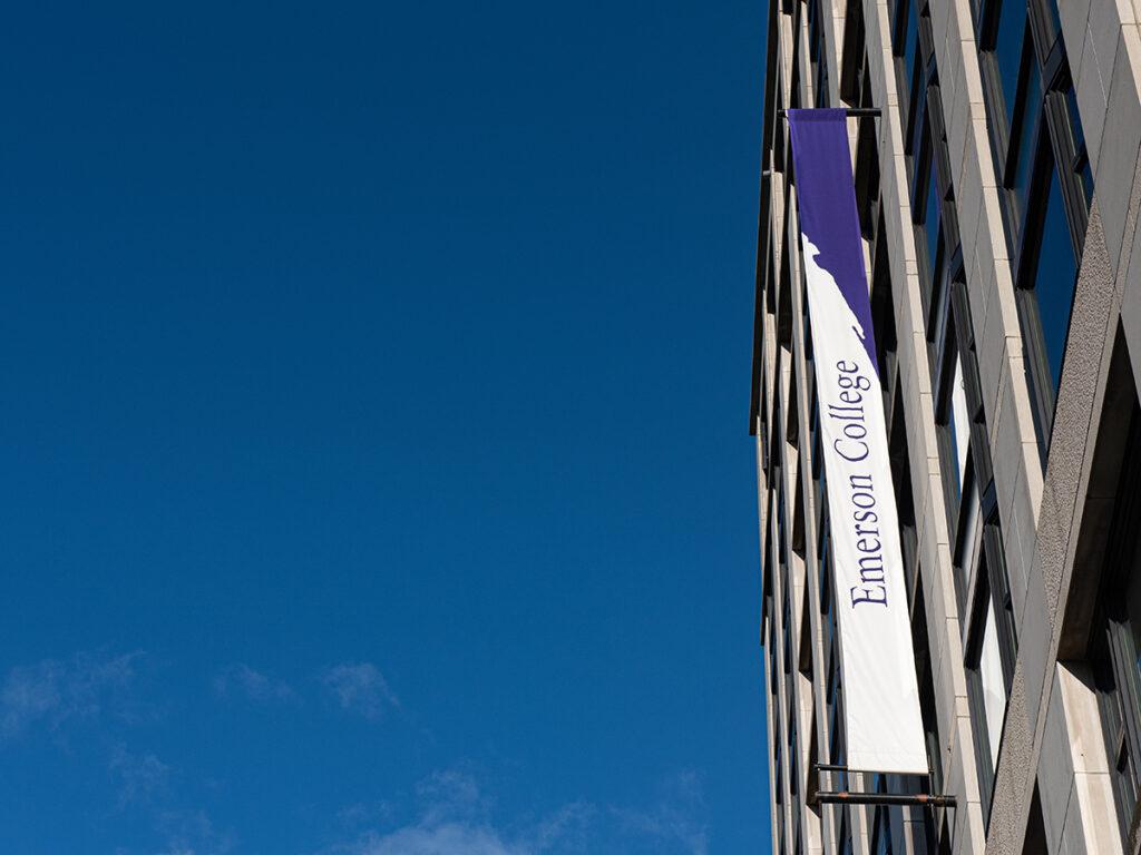 banner on building against blue sky