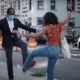 president pelton and student tap feet on street
