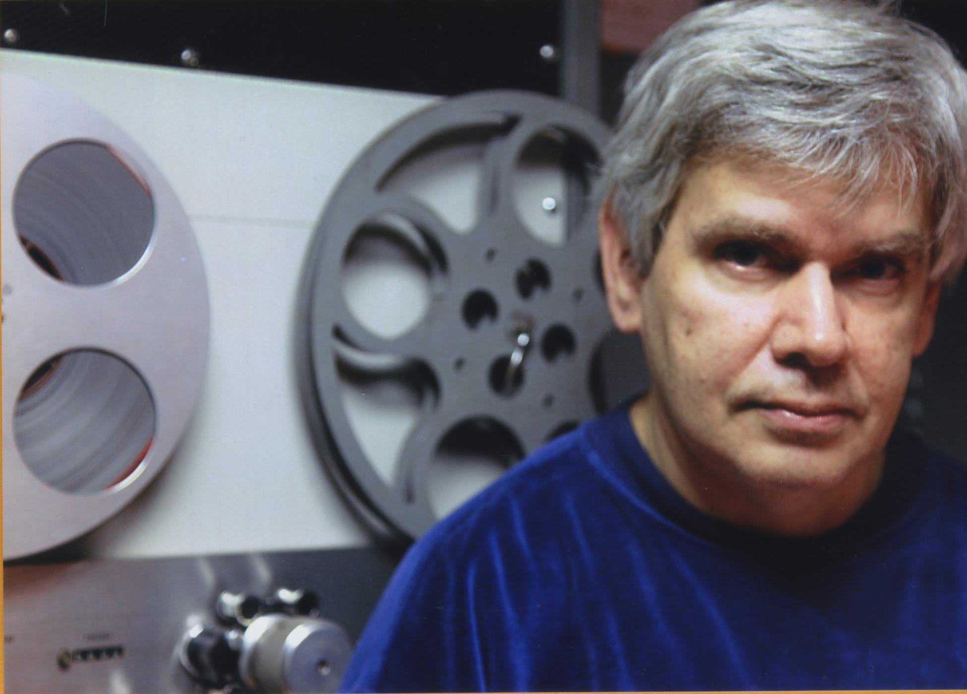 john gianviot with film reels behind him