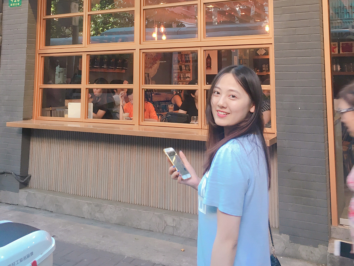 Ye Huang in front of restaurant