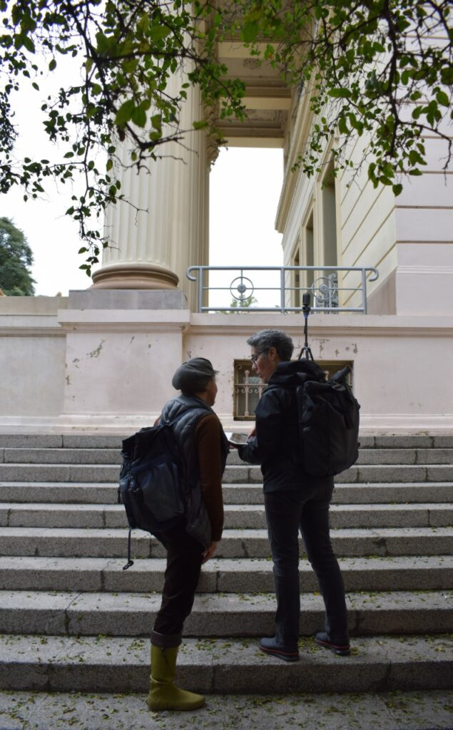 Two women, backs to camera, on museum steps