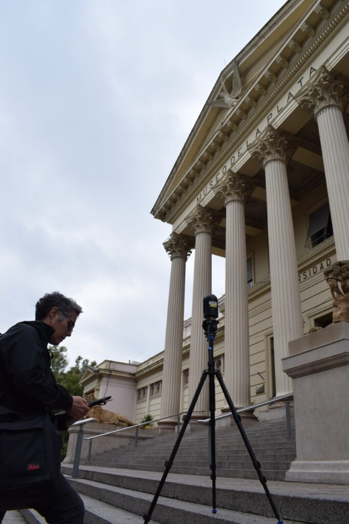 woman setting up camera on museum steps